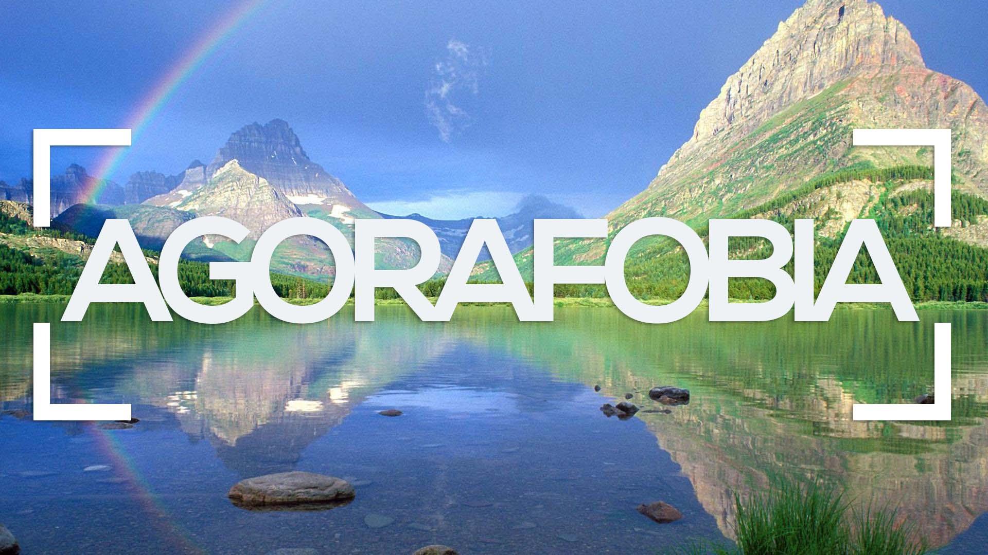 se muestra un paisaje montañoso con arcoiris de fondo y la palabra agorafobia